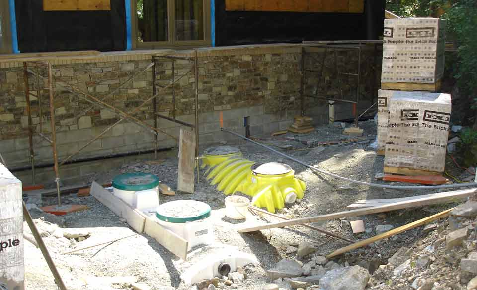 Typical tank and treatment plant installation during new construction