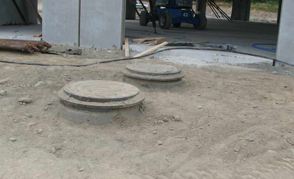 Installation with traffic bearing risers and covers