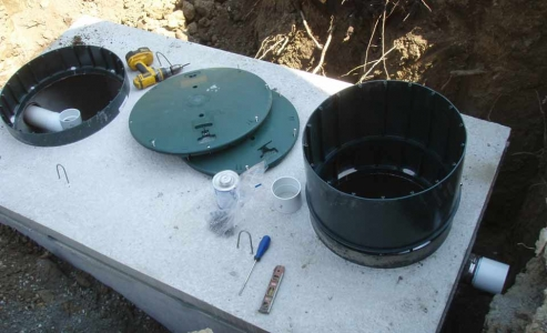 New septic tank riser installation